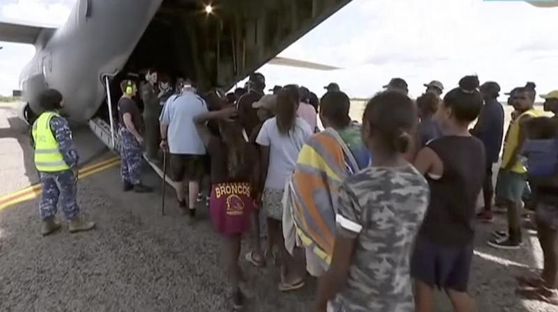 Storm evacuees board an Australian Defence Force C-130 plane preparing to take off from Borroloola, Australia.(Photo:AP)