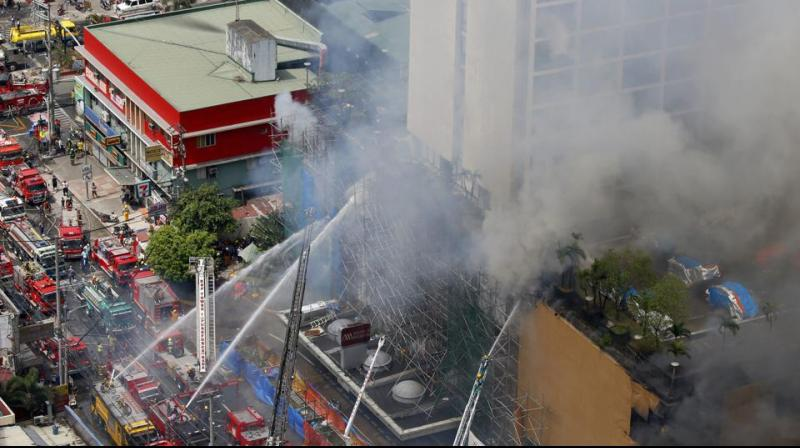 The blaze at the Waterfront Manila Pavilion, a hotel and casino complex, was still raging six hours after it began on Sunday morning, prompting more than 300 people to flee the area and six to be brought to hospital, fire and city officials said. (Photo: AP)