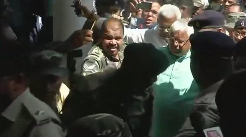 RJD Chief Lalu Yadav has gone to court straight from a hospital where he was admitted after he fell ill inside prison. (Photo: ANI)