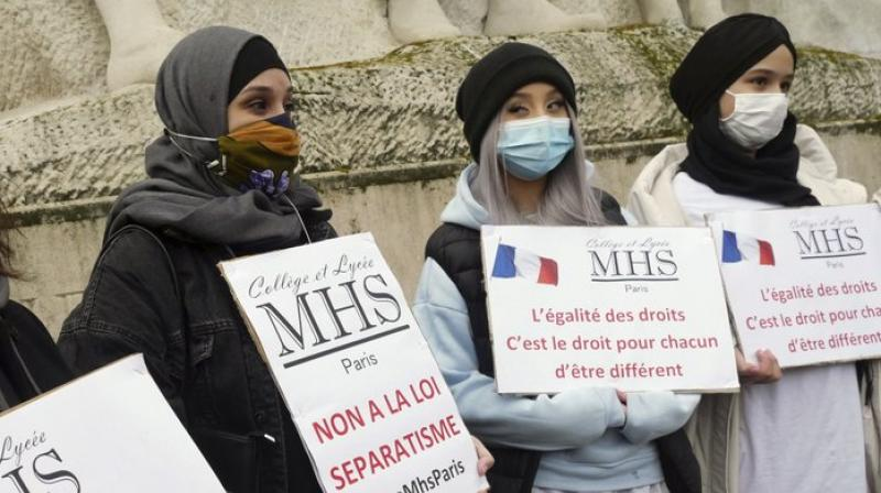 Associations are to sign a charter of respect for French values and pay back state funds if they cross the line (AP)