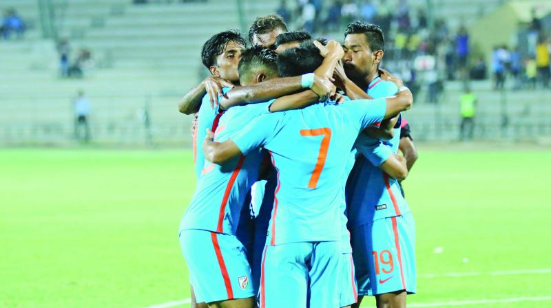Indian players celebrate goal.
