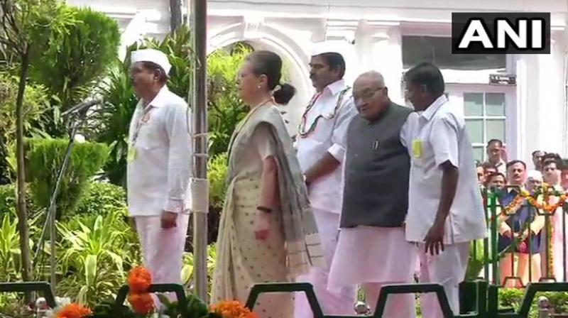 A group of children present on the occasion greeted Sonia Gandhi and Manmohan Singh who presented them sweets. (Photo: ANI)