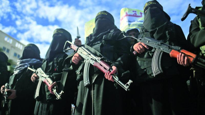 Armed female members of the militant Palestinian group Islamic Jihad carry Kalashnikov assault rifles as they take part in a rally to protest against US President Donald Trump's decision to recognise Jerusalem as the capital of Israel, in Gaza. (Photo: AFP)