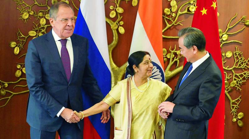 Union Minister for External Affairs Sushma Swaraj with her Chinese counterpart Wang Yi and Russian Foreign Minister Sergey Lavrov  in New Delhi. (Photo: PTI)