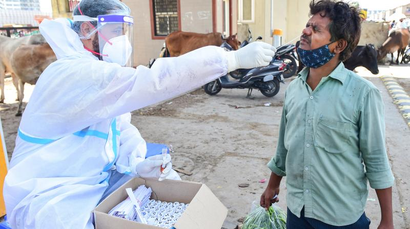 A health worker collects a sample f)r Covid-19 test during lockdown, in New Delhi, Monday, May 24, 2021. (PTI)