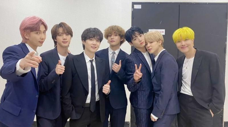 The group, which comprises of Jung Kook, V, Jimin, j-hope, SUGA, Jin and RM, took viewers along to a backstage dressing room and onto a red carpet fitted for the BBMAs. (Twitter)