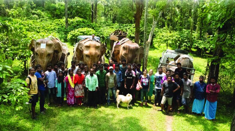 Sculptors next to elephant  statues made of Lantana weed