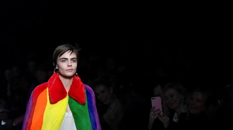 British model Cara Delevingne presents a creation from the Burberry collection during their catwalk show on the second day of London Fashion Week Autumn/Winter 2018 in London on February 17, 2018. (Photo: AFP)
