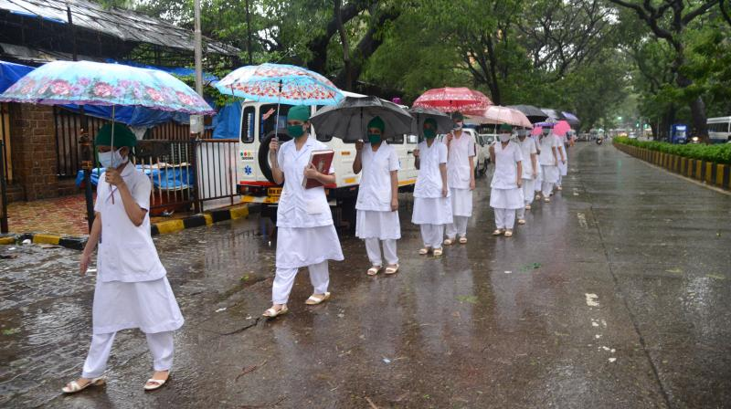 Nurses walk to work at KEM Hospital on a rainy day in Mumbai. India on July 17 became the third country in the world to record one million coronavirus cases, following Brazil and the United States. Experts said the number of cases is expected to shoot up to 2 million in barely another three weeks. (DC Photo: Rajesh Jadhav)