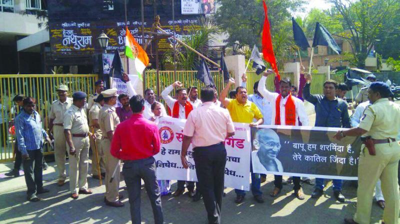 Protestors the venue in Pune.
