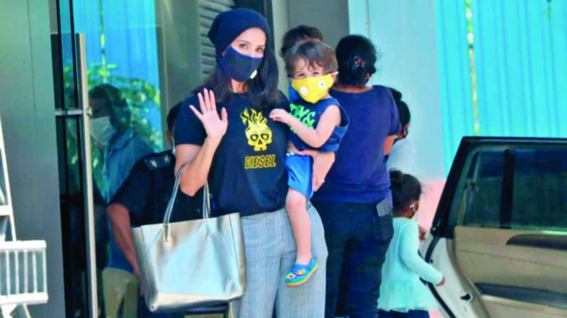 Actress Sunny Leone wearing a mask with her daughter
