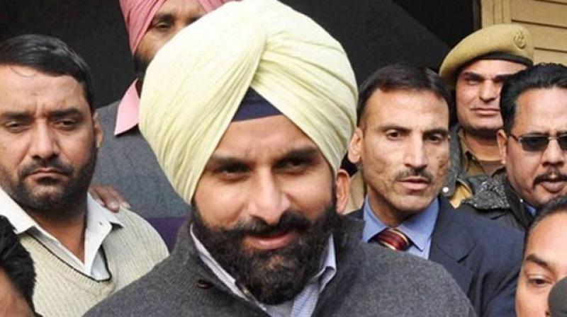 'Two years have passed since this promise. The entire farming community feels cheated. More than 500 farmers have ended their lives when like Budh Singh their loans multiplied because they stopped paying instalments in the hope for of an early waiver,' said SAD leader Bikram Singh Majithia. (Photo: PTI)