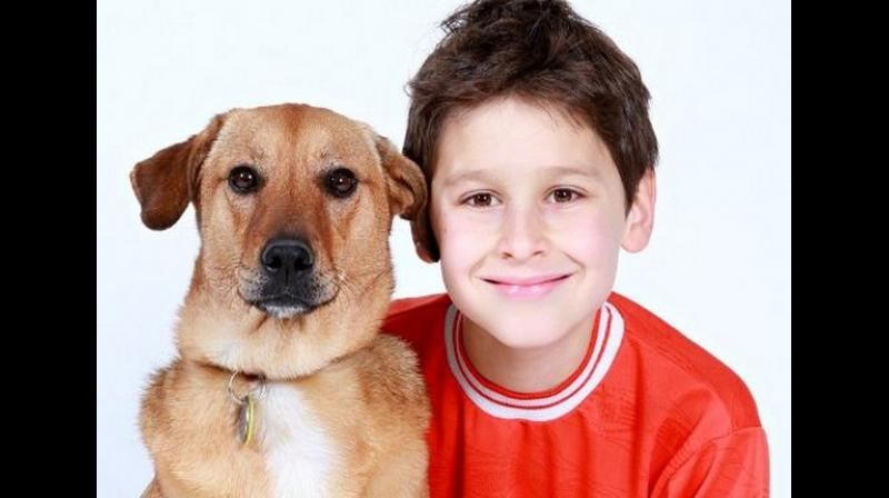 The largest apparent protective effect was found for children who had a household pet dog at birth or were first exposed after birth but before age 3. (Photo: ANI)