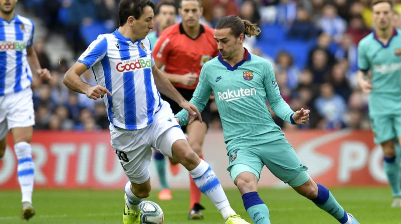Real Sociedad went ahead in the 12th minute with a Mikel Oyarzabal penalty but goals from Antoine Griezmann and Luis Suarez either side of halftime put Barcelona in front, only for Alexander Isak to level shortly after the hour mark. (Photo:AP)