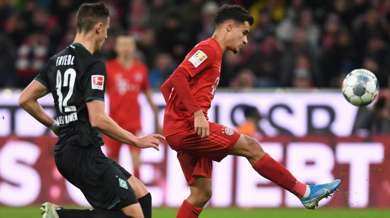Bayern Munich's Philippe Coutinho scored a hat-trick and Robert Lewandowski added two more goals as the champions demolished Werder Bremen 6-1 on Saturday to impressively bounce back from two straight league defeats. (Photo:AFP)