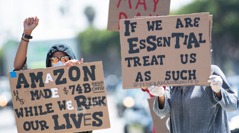 Workers protest against the failure from their employers to provide adequate protections in the workplace of the Amazon delivery hub on National May Day Walkout/Sickout by workers at Amazon, Whole Foods, Innstacart and Shipt amid the Covid-19 pandemic on May 1, 2020, in Hawthorne, California. (Photo | AFP)