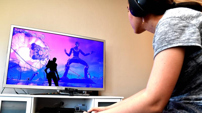 n this file photo 15-year-old Yasmin plays Fortnite featuring Travis Scott Presents: Astronomical on April 23, 2020 in South Pasadena, California. With concerts on hold to halt coronavirus spread, the gaming world is increasingly catering to music lovers, with artists becoming animated performers in virtual realms to the trippy delight of millions. (Photo | AFP)