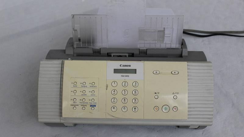 Here's a specimen of a fax machine, if you've never seen one. It functions like a copier machine that sends a photocopy of your paper document to someone on the other end of the phone line.