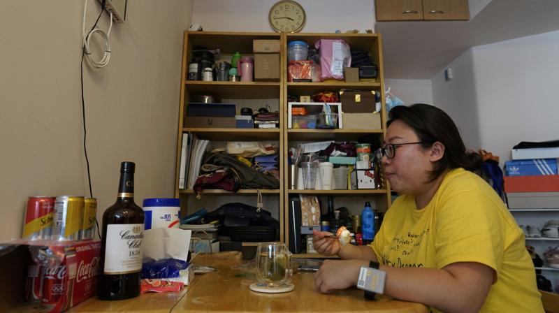 Associated Press reporter Zen Soo eats her lunch at the dining table at home while serving a two-week home quarantine in Hong Kong, April 17, 2020. Hong Kong issued quarantine wristbands to monitor returning residents of the city while they serve their mandatory 14-day quarantine, in a bid to curb local transmissions of COVID-19 during the pandemic. (Photo | AP)