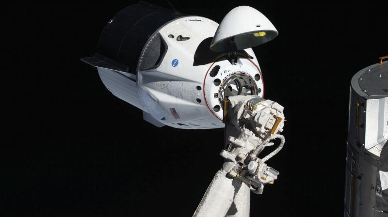 In this March 4, 2019 photo made available by NASA, the uncrewed SpaceX Crew Dragon spacecraft, with its nose cone open to expose the docking mechanism, approaches the International Space Station's Harmony module. It was the first Commercial Crew vehicle to visit the ISS. (Photo | AP)