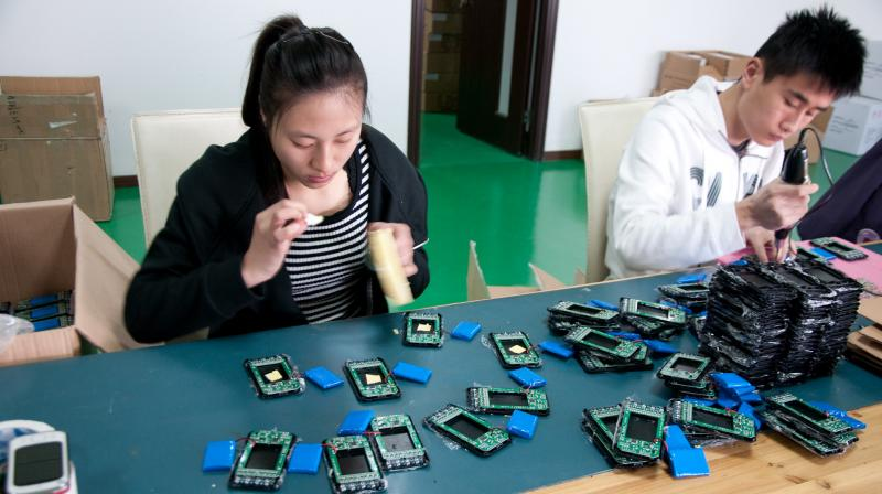 Electronics being assembled in a facility in Shanghai. (Photo | Flickr- Mitch Altman)