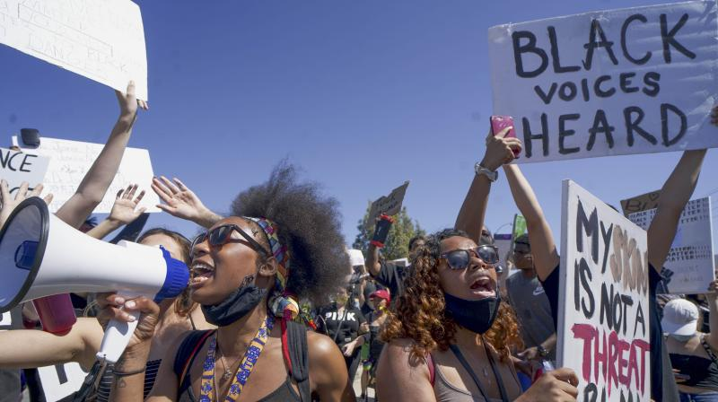 The century-old technology firm called for responsible national standards regarding how facial recognition systems should be used by police agencies. In this photo Black Lives Matter demonstrators march on June 7 in Santee, California. (Photo | AFP)