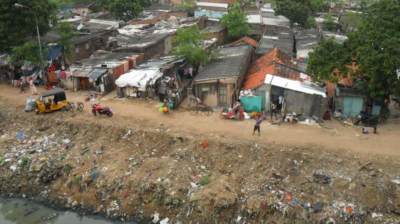 Poor people in Chennai living on the banks of a canal in makeshift homes. (Photo | Wikimedia Commons -  Milei Vencel)