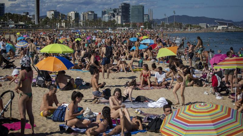 The AI-based system captures images of the field view and computes the distance as per criteria set by the Ministry of Health and Family Welfare. In this representative image, people enjoy the warm weather on the beach in Barcelona, Spain, Saturday, June 13, 2020. The Spanish government has announced that the northwestern region of Galicia will move next week to what the government calls