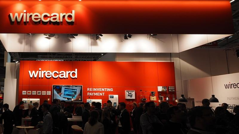 Wirecard is a payments processor, offering companies services allowing them to accept credit cards and digital payments like Apple Pay or Paypal in stores, online or on mobile. In the picture, the Internet World Fair 2017 in Munich, Germany, Wirecard-Stand (Photo | Wikimedia Commons - Ordercrazy)