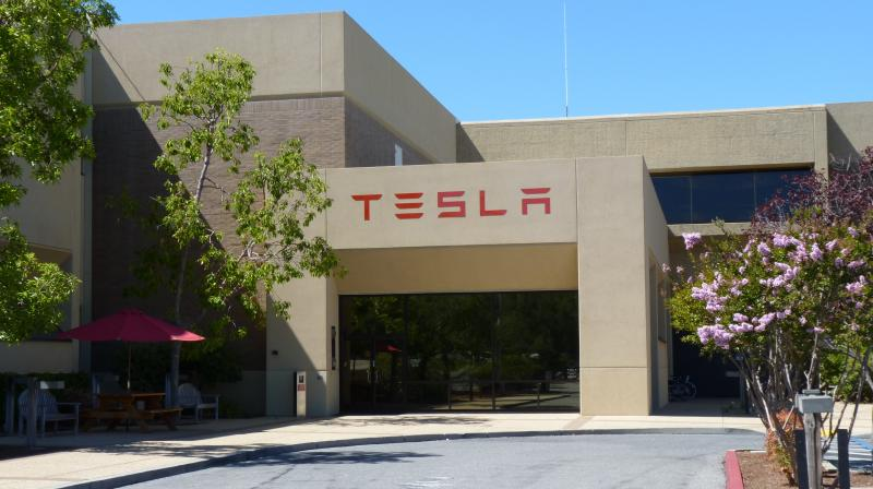While Trump has argued the temporary freeze was aimed at helping US workers facing high unemployment during the coronavirus pandemic, critics said the move would backfire and hurt one of the key segments of the American economy. In this picture, a view of Tesla headquarters in Palo Alto, in the San Francisco Bay Area, considered part of 'Silicon Valley' in the United States. (Photo | Wikimedia Commons - Tumbenhaur)