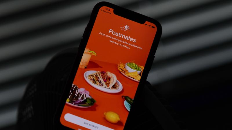 Uber's ride sharing business has faced losses due to the restriction on movement and travel across the world but its food delivery arm is doing well, and is now expanding with the acquisition of Postmates. (Photo | AFP)