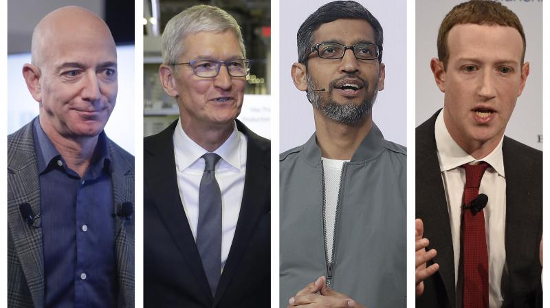 Pressure has been growing both from the right and the left—and sometimes internally—to do something about the overwhelming dominance of the internet platforms. In this photo, Jeff Bezos, Tim Cook, Sundar Pichai and Mark Zuckerberg. (Photo | AP)