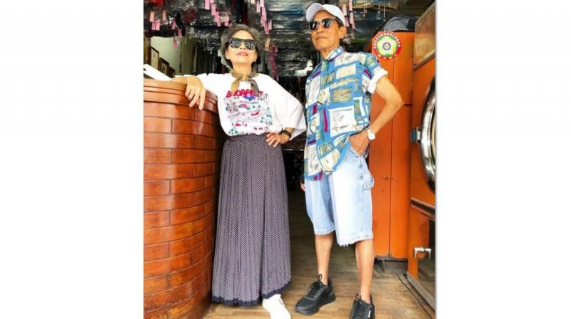 Over the years, customers have either forgotten or failed to collect reams of clothing that the couple, Hsu Sho-er, 84 and her husband Chang Wan-ji, 83, never felt able to throw away. Grandson Reef Chang, 31, hit upon the idea of using the clothes to alleviate the couple's boredom, and featured them on the Instagram account @wantshowasyoung modelling the clothes. (Photo | Instagram - @wantshowasyoung)
