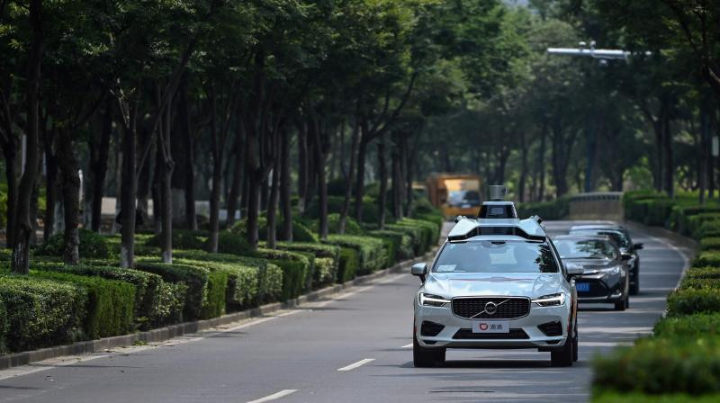 Chinese consumers—known for eagerly embracing e-commerce, online payments and other digital solutions—are lining up for a spin in DiDi Chuxing's self-developed autonomous taxis at a Shanghai pilot project launched in June. (Photo | AFP)