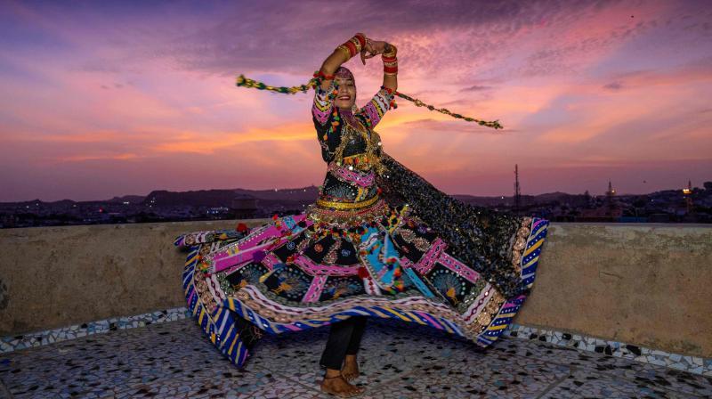 In this picture taken on August 13, 2020, Kalbeliya gypsy dancer Aasha Sapera practices before hosting online dance classes amid the COVID-19 coronavirus pandemic in Jodhpur. (Photo | AFP - Sunil Verma)