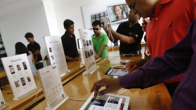Apple is a small player in India, where sales of its smartphones lag those of South Korean rival Samsung. The company currently sells through third-party retailers in India including Amazon, and the country is seen as a huge potential market for the firm due to its giant 1.3-billion population and relatively low number of smartphone owners. (Photo | AP)