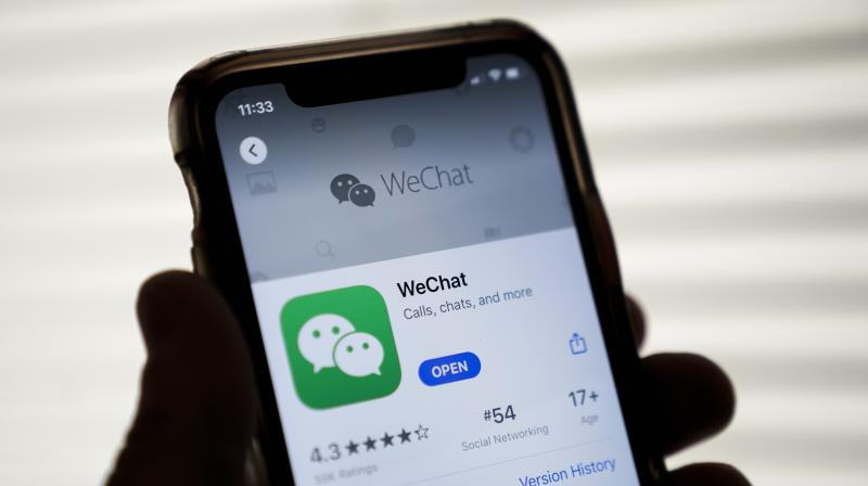 """An announcement by China's Ministry of Commerce that came after US's decision to ban WeChat and TikTok did not mention any specific foreign entities that could be targeted. But it said the new system would consider sanctions on entities whose activities """"harm China's national sovereignty, security, and development interests"""" or violate """"internationally accepted economic and trade rules"""". (Photo 