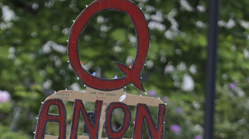 "QAnon centres on the baseless belief that President Donald Trump is waging a secret campaign against enemies in the ""deep state"" and a child sex trafficking ring run by satanic paedophiles and cannibals. The corporate support for a QAnon-promoting politician is another example of how the conspiracy theory has penetrated mainstream politics, spreading beyond its origins on internet message boards popular with right-wing extremists. (Photo 