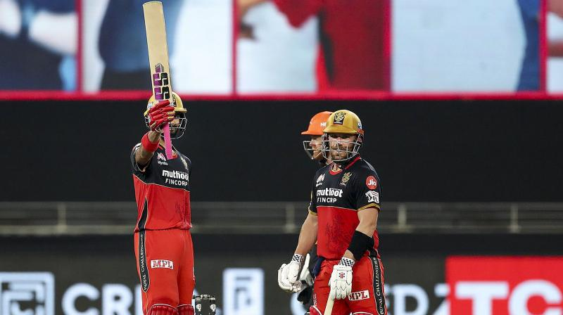 Royal Challengers Bangalore batsman Devdutt Padikkal raises his bat after completing a half-century during a cricket match of IPL 2020 against Sunrisers Hyderabad, at Dubai International Cricket Stadium, Dubai, United Arab Emirates, Monday, Sept. 21, 2020. (Photo | PTI)