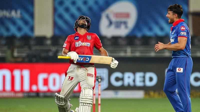Before the KXIP vs Delhi Capitals match went into Super Over, the TV footage showed that square leg umpire Nitin Menon had erred in calling Chris Jordan for a 'short run' in the third ball of the 19th over, bowled by Kagiso Rabada. This photo from the same match shows Kings XI Punjab player Mayank Agarwal reacting after Delhi Capitals player Marcus Stoinis took his wicket during the cricket match of IPL 2020, at Dubai International Cricket Stadium, Dubai, United Arab Emirates, Sunday, Sept. 20, 2020. (Photo | PTI)