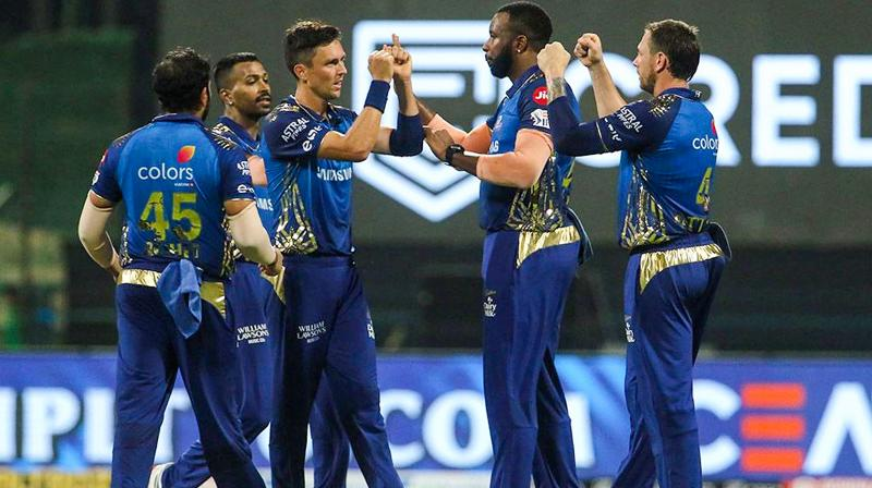 Mumbai Indians players celebrate the wicket of Kolkata Knight Riders batsman Shubman Gill during IPL 2020 cricket match, at Sheikh Zayed Stadium, in Abu Dhabi of United Arab Emirates, Wednesday, Sept. 23, 2020. (Photo | PTI)
