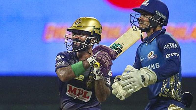 Kolkata Knight Riders batsman Dinesh Karthik plays a shot during IPL 2020 cricket match against Mumbai Indians, at Sheikh Zayed Stadium, in Abu Dhabi of United Arab Emirates, Wednesday, Sept. 23, 2020. The defensive strategy adopted by a team now coached by Kiwi great Brendon McCullum who is known for his aggressive mindset defied logic. (Photo | PTI)