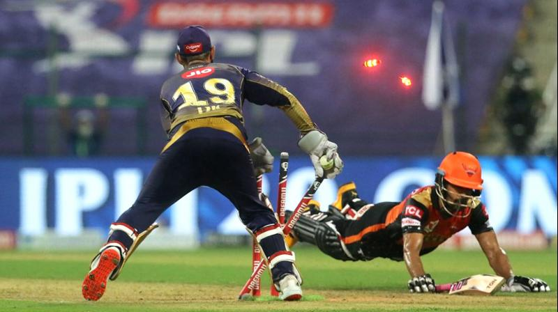 Unlike their last match against Mumbai Indians, KKR looked more intent and aggressive with their approach, having brought in Sunil Narine and Pat Cummins up front with the new ball. In this photo, Skipper Dinesh Karthik of Kolkata Knight Riders runs out Wriddhiman Saha of Sunrisers Hyderabad during their Indian Premier League 2020 cricket match at the Sheikh Zayed Stadium, Abu Dhabi, Saturday, Sept. 26,2020. (Photo | PTI)