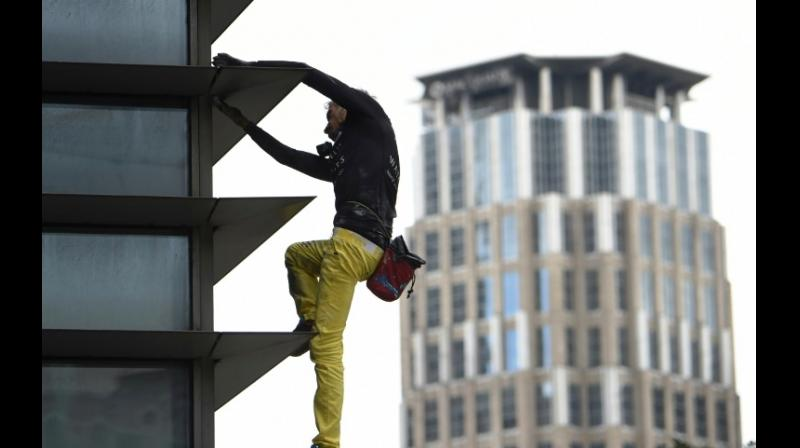 Alain Robert, dubbed the 'French Spider-Man', has scaled more than 100 structures without ropes or other safety equipment. (Photo: AFP)