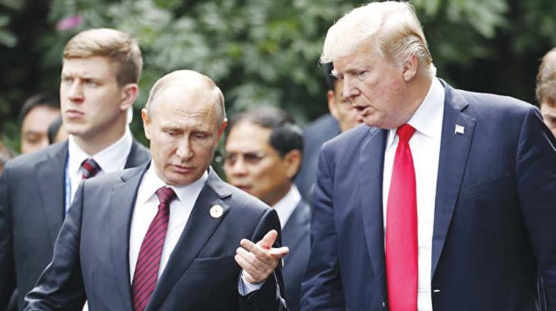 US President Donald Trump with his Russian counterpart Vladimir Putin at the APEC summit in Vietnam. (Photo: AP )