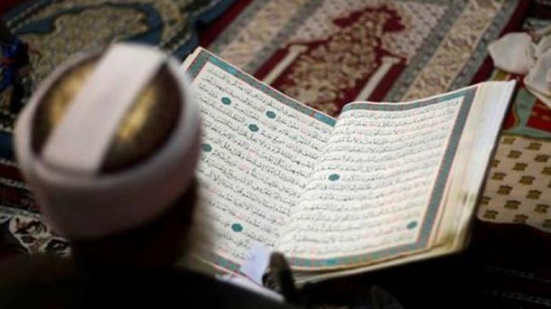 A person reading the Holy Quran.
