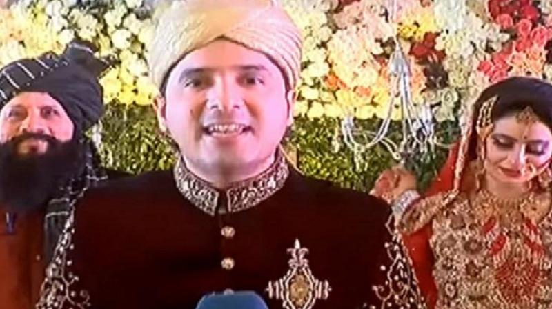 Appearing on-air in his wedding attire, the TV reporter covered the 'breaking news' and interviewed his father, wife, mother-in-law and even his own mother. (Photo: Youtube screengrab)