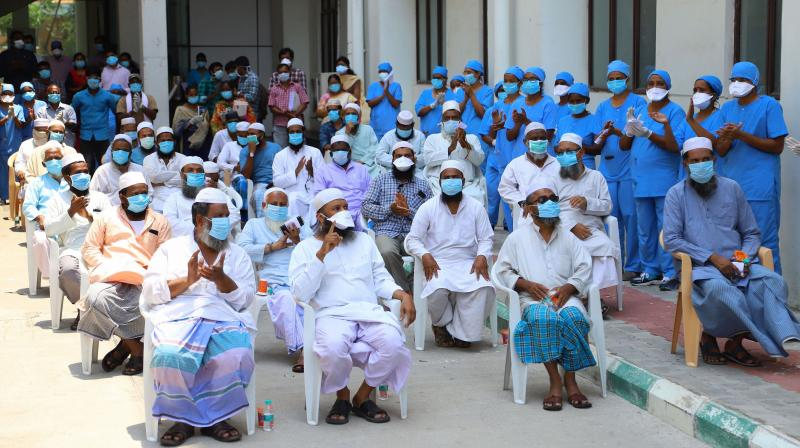 Medical staff applaud as 35 formerly Covid-19 positive patients are discharged after their quarantine period from Omandurar Government Medical College in Chennai on Friday, April 17, 2020. (PTI)