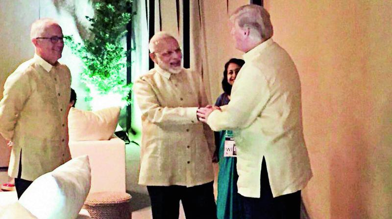 Prime Minister Narendra Modi shakes hands with US President Donald Trump before the pre-Asean summit gala dinner in Manila. (Photo: PTI)