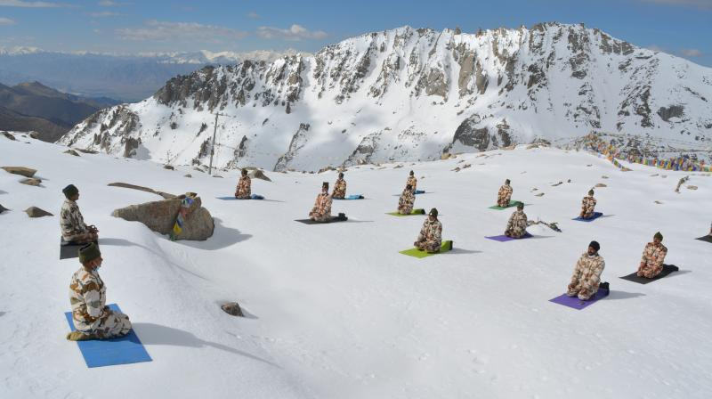 Indian soldiers perform yoga to mark the International Day of Yoga, in Ladakh on June 21, 2020. (PTI)
